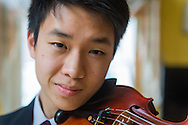 Samuel Wang plays pauses for a photograph at his home in Medford, NJ, Friday, April 3, 2015.  Wang has earned his a place with the National Youth Orchestra of the USA for a second season. Photo by Bryan Woolston.