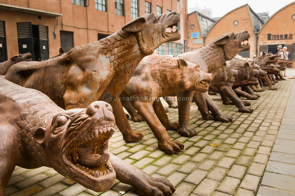 "Artist Liu Ruo Wang's 2008 cast iron sculpture titled ""Wolf Coming!"" in the 798 Art Zone or Dashanzi Art District in Beijing, China (Not Released)."