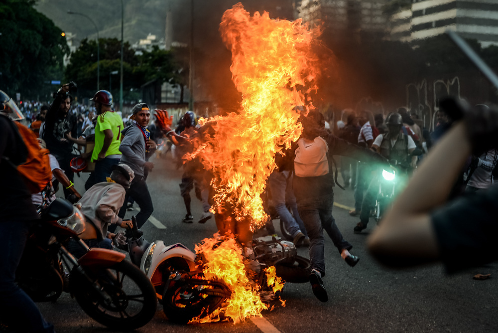 "CARACAS, VENEZUELA - MAY 20, 2017: Orlando Figuera was accused of stealing, then beaten, stabbed and set on fire during an anti-government protest. Lynchings are on the rise in Venezuela - consequential of skyrocketing crime and a corrupt judicial system. Mr. Figuera died in the hospital from his injuries. His death was very controversial.  President Maduro tried to make his death political - and announced on state television that he was set on fire because he was a ""Chavista"" - a government supporter.  PHOTO: Meridith Kohut"