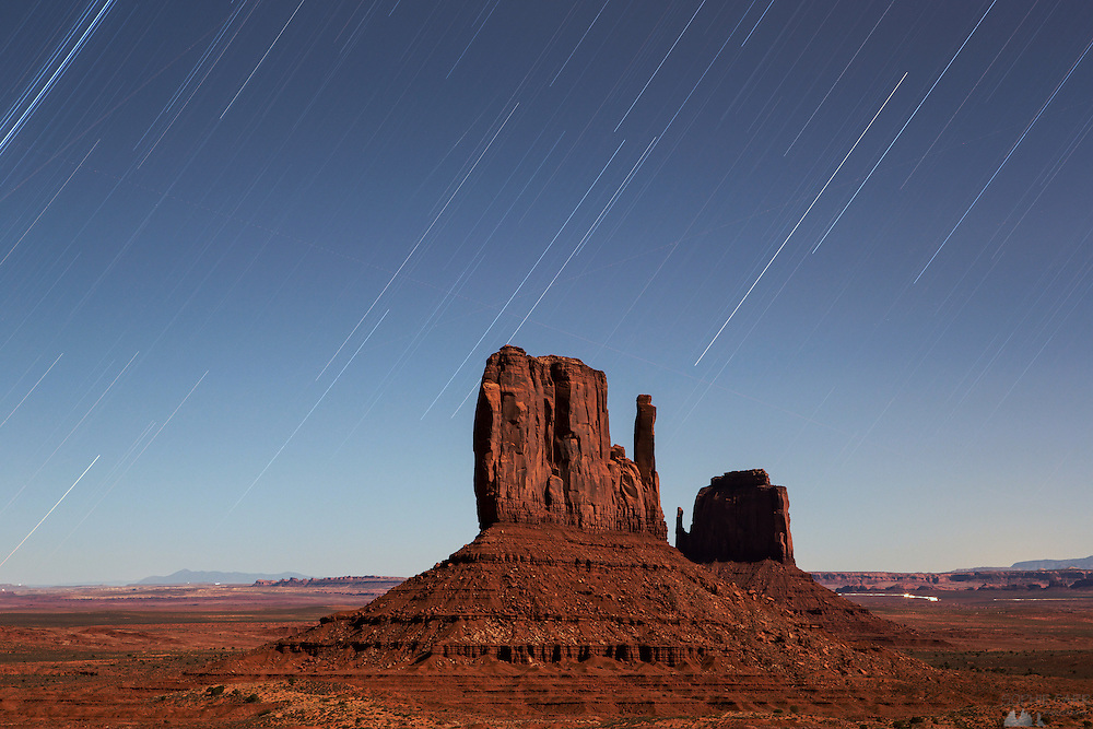 Star trails over The Mittens at Monument Valley on a moonlit night