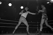 25/01/1963<br /> 01/25/1963<br /> 25 January 1963<br /> National Junior Boxing Championships at the National Stadium, Dublin. Picture shows D. Murphy, (left) of Matt Talbot Boxing Club, Cork in his contest against H. Turkington of Belfast (Doagh) in the Welterweight Semi-Final at the National Stadium.