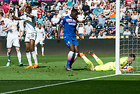 Football - 2017 / 2018 Premier League - Swansea City vs. Stoke City<br /> <br /> Jack Butland of Stoke City saves the shot of Tammy Abraham of Swansea City, at The Liberty Stadium.<br /> <br /> COLORSPORT/WINSTON BYNORTH