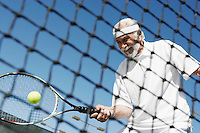Man About to Hit a Tennis Ball