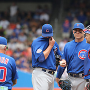 NEW YORK, NEW YORK - July 03: Pitcher Jon Lester #34 of the Chicago Cubs is pulled by Manager Joe Maddon #70 of the Chicago Cubs after giving up seven runs in the second innings during the Chicago Cubs Vs New York Mets regular season MLB game at Citi Field on July 03, 2016 in New York City. (Photo by Tim Clayton/Corbis via Getty Images)