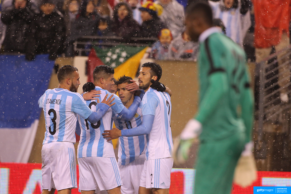 Sergio Aguero, Argentina, is congratulated by team mates after scoring his sides first goal during the Argentina Vs Ecuador International friendly football match at MetLife Stadium, New Jersey. USA. 31st march 2015. Photo Tim Clayton