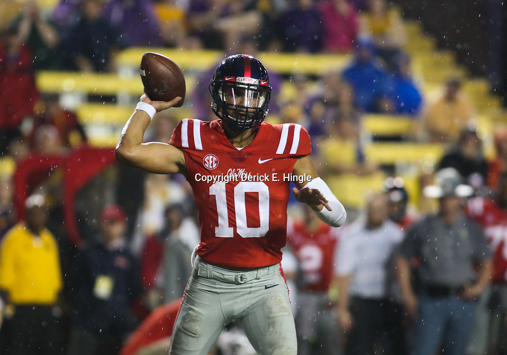 Sep 29, 2018; Baton Rouge, LA, USA; Mississippi Rebels quarterback Jordan Ta'amu (10) passes against the LSU Tigers during the second half of a game at Tiger Stadium. Mandatory Credit: Derick E. Hingle-USA TODAY Sports