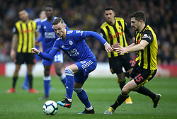 Leicester City's James Maddison (left) and Watford's Craig Cathcart battle for the ball during the Premier League match at Vicarage Road, Watford.