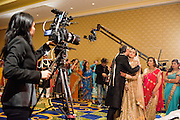 "Baltimore, Maryland - December 20, 2014: Trisha Satya Pasricha is kissed by her father Pankaj while he and Trisha's mother Reena, right, leave her to ascend the mandap, a traditional Hindu structure where the wedding takes place, in one of the Baltimore Marriott Waterfront Hotel's ballrooms. Trisha, who studied film at Harvard, and met Eshwan after she cast him in one of her films, says she was ""very aggressive"" about finding the right crew to record her wedding. <br /> <br /> Trisha Satya Pasricha and Eshwan Ramudu married at the Baltimore Marriott Waterfront Hotel December 20, 2014. <br /> <br /> <br /> CREDIT: Matt Roth for The New York Times<br /> Assignment ID: 30168620A"