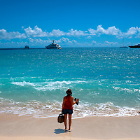 St. Martin St. Maarten -- February 2011 -- Visitors watch yachts move by on the Caribbean island of St. Martin / St. Maarten, which is split between France and the Netherlands.  (Photo by Chip Litherland)