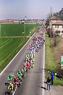 The peloton passes under a highway bridge during Milano Sanremo 2016 (296 km)