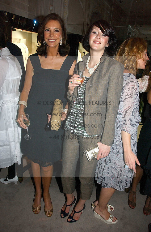Left to right, MARINA ZANGRELLI and KATIE TURNER at a party to celebrate the re-opening of the David Morris Flagship store at 180 New Bond Street, London on 14th June 2006.<br />