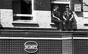 Girls Sitting on a Windowsill, High Wycombe, UK, 1980s.