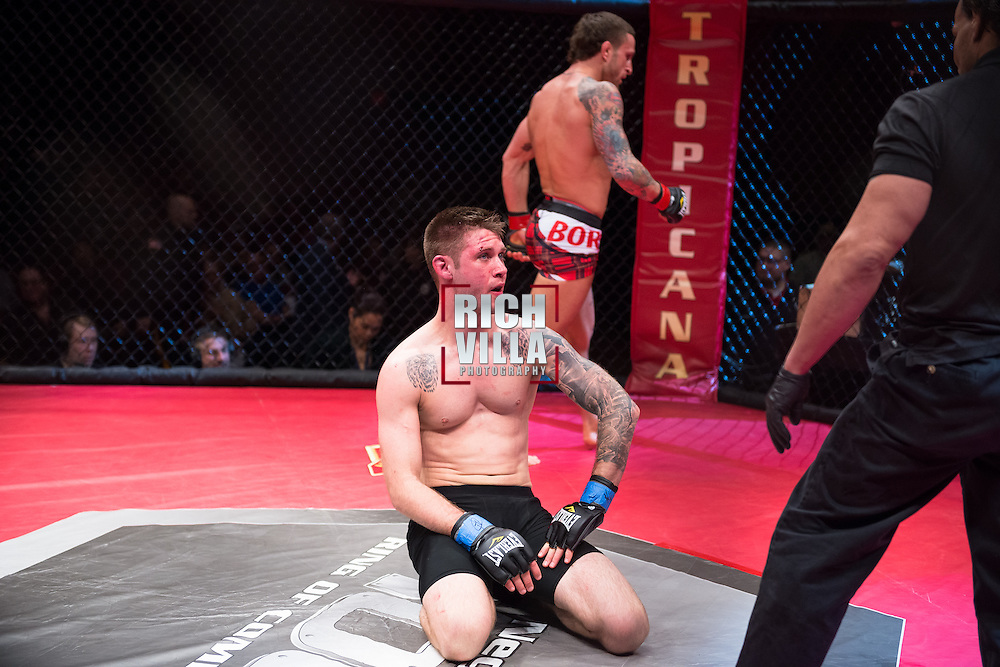 Atlantic City, New Jersey, January 24, 2014: Kenny Guadreau(black shorts) disappointed after loosing to Gregor Gillespie(red/black shorts) at Ring of Combat 47 at The Tropicana Casino.