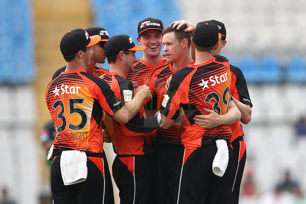 Sam Whiteman of the Perth Scorchers and Jason Behrendorff of the Perth Scorchers are congratulated for getting Cameron Delport of the Dolphins wicket during match 4 of the Oppo Champions League Twenty20 between the Dolphins and the Perth Scorchers held at the Punjab Cricket Association Stadium, Mohali, India on the 20th September 2014<br /> <br /> Photo by:  Shaun Roy / Sportzpics/ CLT20<br /> <br /> <br /> Image use is subject to the terms and conditions as laid out by the BCCI/ CLT20.  The terms and conditions can be downloaded here:<br /> <br /> http://sportzpics.photoshelter.com/gallery/CLT20-Image-Terms-and-Conditions-2014/G0000IfNJn535VPU/C0000QhhKadWcjYs