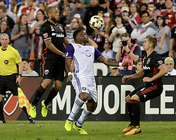 September 9, 2017 - Washington, DC, USA - 20170909 - Orlando City FC forward CYLE LARIN (9) plays the ball forward between D.C. United defender NICK DELEON (14), left, and D.C. United midfielder RUSSELL CANOUSE (4) in the first half at RFK Stadium in Washington. (Credit Image: © Chuck Myers via ZUMA Wire)