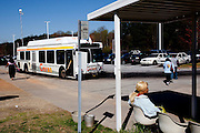April Hobbs sits at a CTRAN bus stop March 31, 2010. That day marked Clayton County, Georgia's last day of the county's public bus system, CTRAN, running.