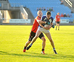 Kiltimagh's Stephen McDonnell gets tackeled by Ballyhaunis's Kevin Gallagher during the Intermediate quarter final clash at McHale park.<br /> Pic Conor McKeown