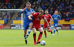 George Cooper of Peterborough United in action with Nicky Devlin of Walsall - Mandatory by-line: Joe Dent/JMP - 27/04/2019 - FOOTBALL - Banks's Stadium - Walsall, England - Walsall v Peterborough United - Sky Bet League One