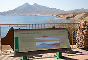 Information panel about Los Frailes volcanoes, Cabo de Gata national park, Almeria, Spain