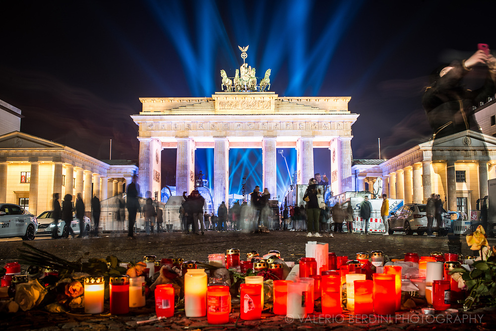 Candles left at Brandenburg gate in memory of the victims of the terrorist attack that hit a Berlin Christmas Market days before the New Year's eve 2016 celebrations.