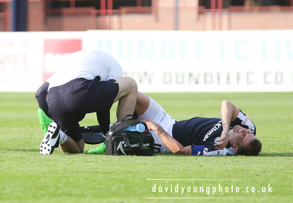 Dundee physio Gerry Docherty treats Kevin Thomson - Dundee v Motherwell - Ladbrokes Premiership at Dens Park<br /> <br /> <br />  - &copy; David Young - www.davidyoungphoto.co.uk - email: davidyoungphoto@gmail.com
