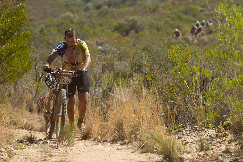 The heat took its toll on the climbs during stage 1 of the 2012 Absa Cape Epic Mountain Bike stage race held from Robertson Primary School in Robertson, South Africa on the 26 March 2012..Photo by Greg Beadle/Cape Epic/SPORTZPICS