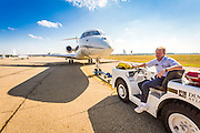 Towing a Bombardier Global Express jet into position for a photographic session.  Kalamazoo International Airport, Kalamazoo, Michigan.