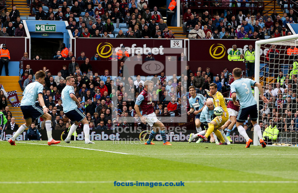 Tom Cleverley (centre) of Aston Villa scores his sides first goal during the Barclays Premier League match at Villa Park, Birmingham<br /> Picture by Tom Smith/Focus Images Ltd 07545141164<br /> 09/05/2015
