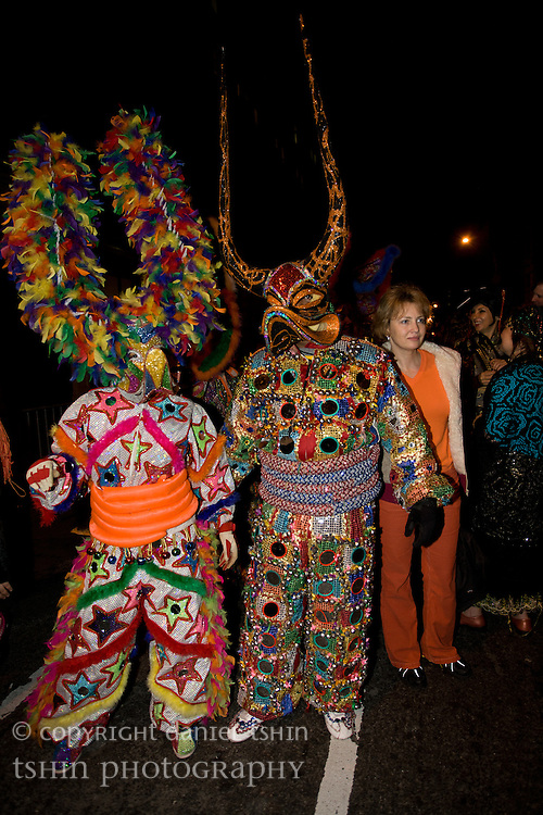 Two revelers dressed in elaborate costumes