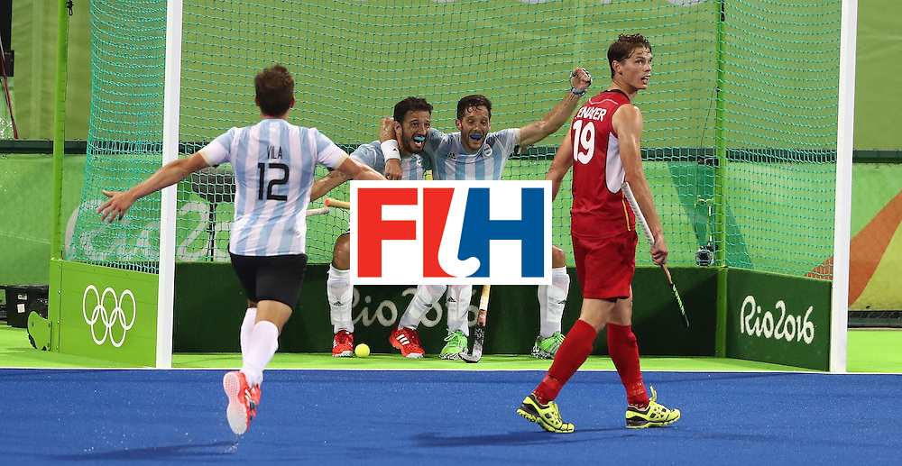 RIO DE JANEIRO, BRAZIL - AUGUST 18:  Agustin Mazzilli (2nd L) of Argentina celebrates with team mates after scoring their fourth goal during the Men's Gold Medal match between Argentina and Belgium on Day 13 of the Rio 2016 Olympic Games held at the Olympic Hockey Centre on August 18, 2016 in Rio de Janeiro, Brazil.  (Photo by David Rogers/Getty Images)