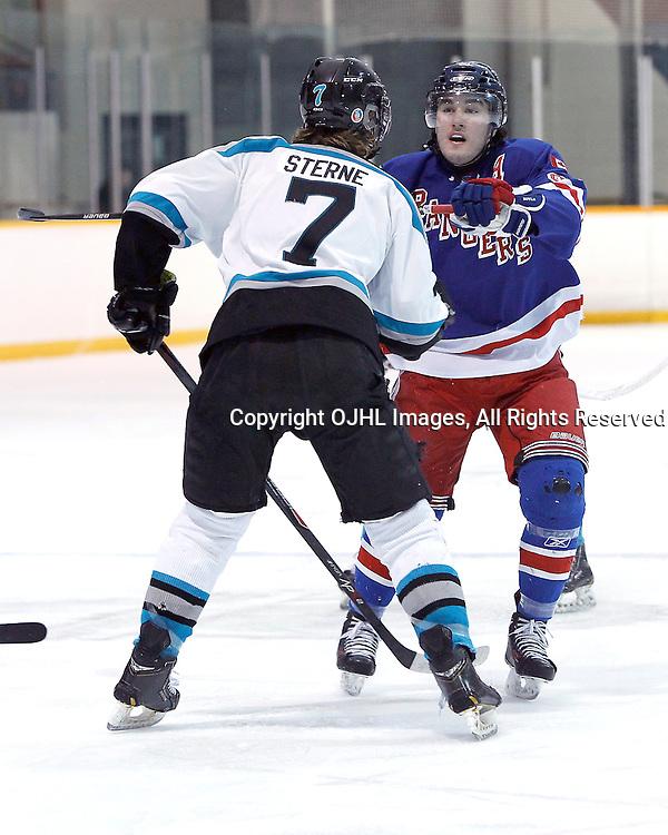 Lindsay, ON - Jan 31 : Ontario Junior Hockey League game action between the Lindsay Muskies and the North York Rangers. James Sterne #7 of the Lindsay Muskies Hockey Club makes the hit on John Carpino #91 of the North York Rangers Hockey Club.<br /> (Photo by Tim Bates / OJHL Images)