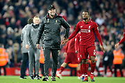 A happy Liverpool Manager Jurgen Klopp with Liverpool midfielder Georginio Wijnaldum (5) during the Premier League match between Liverpool and Everton at Anfield, Liverpool, England on 2 December 2018.