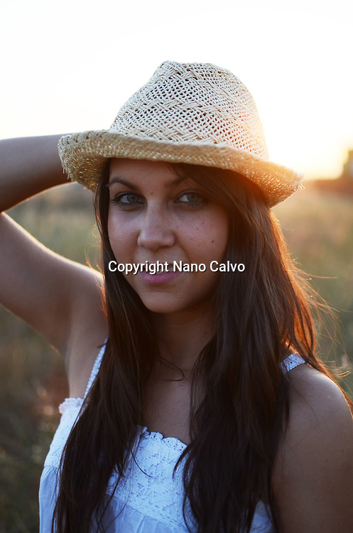 Exterior portrait of cute young woman