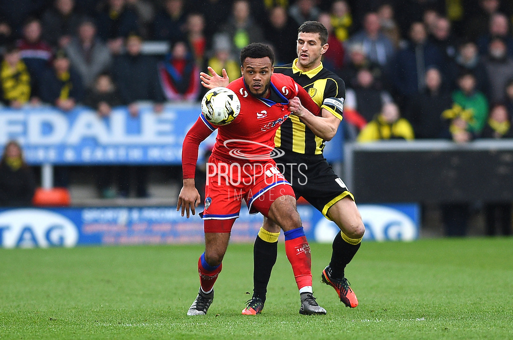 Burton Albion midfielder John Mousinho (capt) and Oldham Athletic defender Tareip Holmes-Dennis during the Sky Bet League 1 match between Burton Albion and Oldham Athletic at the Pirelli Stadium, Burton upon Trent, England on 26 March 2016. Photo by Jon Hobley.