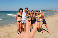 group of friends on a beach, Puglia, Italy