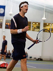 Virginia's Drew Courtney celebrates a point in #3 doubles against VT.   The #1 ranked Virginia Cavaliers faced the #31 ranked Virginia Tech Hokies in NCAA Men's Tennis at the Boar's Head Sports Club in Charlottesville, VA on February 27, 2009.