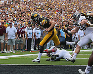 September 07 2013: Iowa Hawkeyes quarterback Jake Rudock (15) runs 6 yards for a touchdown during the first quarter of the NCAA football game between the Missouri State Bears and the Iowa Hawkeyes at Kinnick Stadium in Iowa City, Iowa on September 7, 2013. Iowa defeated Missouri State 28-14.