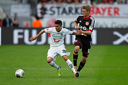 28.09.2013, BayArena, Leverkusen, GER, 1. FBL, Bayer 04 Leverkusen vs Hannover 96, 7. Runde, im Bild Zweikampf zwischen Leonnardo Bittencourt #32 (Hannover 96) und Lars Bender #8 (Bayer 04 Leverkusen). (v.l.). Aktion, Action // during the German Bundesliga 7th round match between Bayer 04 Leverkusen and Hannover at the BayArena, Leverkusen, Germany on 2013/09/28. EXPA Pictures © 2013, PhotoCredit: EXPA/ Eibner/ Grimme<br /> <br /> ***** ATTENTION - OUT OF GER *****
