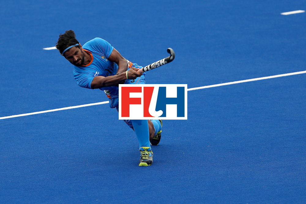 RIO DE JANEIRO, BRAZIL - AUGUST 08:  Rupinder Pal Singh #3 of India passes the ball against Germany during a Men's Pool B match on Day 3 of the Rio 2016 Olympic Games at the Olympic Hockey Centre on August 8, 2016 in Rio de Janeiro, Brazil.  (Photo by Sean M. Haffey/Getty Images)