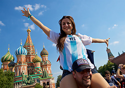 MOSCOW, RUSSIA - Monday, June 18, 2018: A female Argentina supporter poses for a photograph on the shoulders of a her friend in front of Saint Basil's Cathedral in Moscow's Red Square during the FIFA World Cup Russia 2018. (Pic by David Rawcliffe/Propaganda)