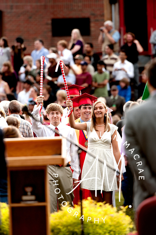 Class Marshalls Jared Guilmett and Emily Compton lead the LHS Class of 2010 to the stage at the Laconia High School athletic field for the 2010 Commencement exercises.  (Alan MacRae/for the Citizen)