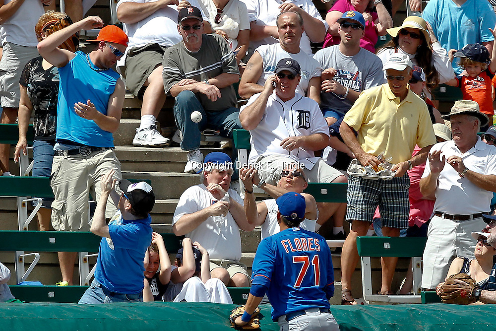 March 14, 2012; Lakeland, FL, USA; New York Mets third baseman Wilmer Flores (71) looks on as fans scramble for a foul ball during the bottom of the third inning of a spring training game against the Detroit Tigers at Joker Marchant Stadium. Mandatory Credit: Derick E. Hingle-US PRESSWIRE