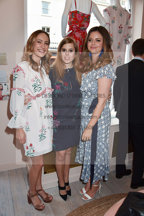 Left to right, Lavinia Brennan, Princess Beatrice Of York and Lady Natasha Rufus Isaacs at the launch of the Beulah Flagship store, 77 Elizabeth Street, London England. 16 May 2018.
