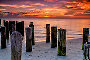 Sunset on the beach at old Naples Pier, Florida