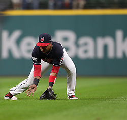October 11, 2017 - Cleveland, OH, USA - Cleveland Indians second baseman Jose Ramirez fields a grounder by the New York Yankees' Greg Bird in the third inning during Game 5 of the American League Division Series, Wenesday, Oct. 11, 2017, at Progressive Field in Cleveland. (Credit Image: © Phil Masturzo/TNS via ZUMA Wire)
