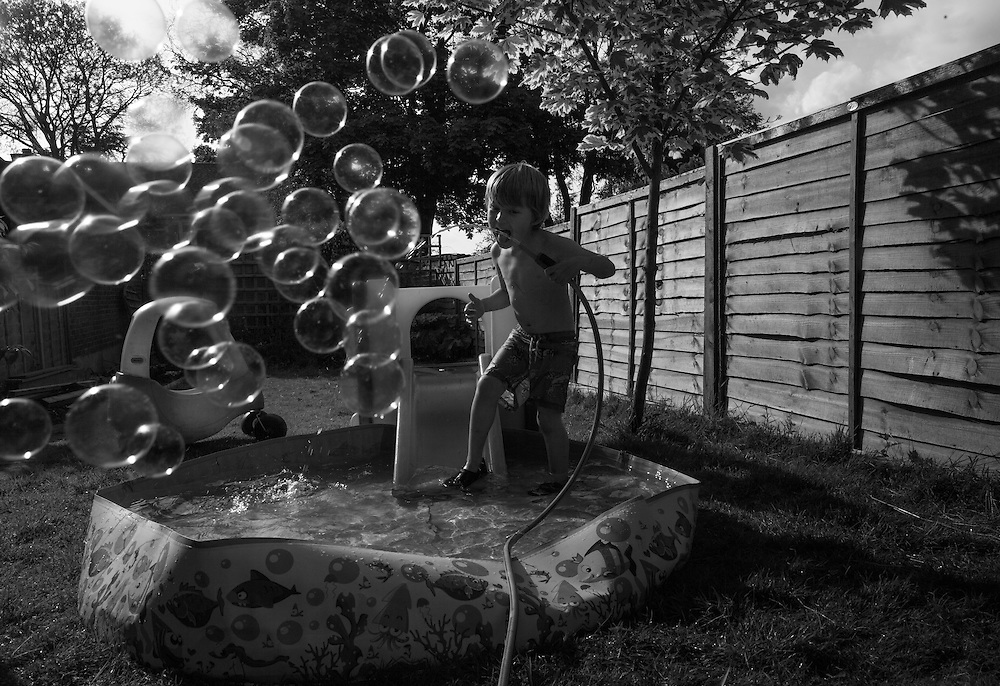 Ben and Joe play in the paddling pool in the backyard in Berkhamsted, England Tuesday, June 16, 2015 (Elizabeth Dalziel) #thesecretlifeofmothers #bringinguptheboys #dailylife