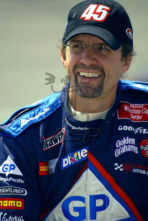 Kyle Petty smiles for the cameras before the start of the Auto Club 500 NASCAR Winston Cup race at the California Speedway in Fontana, CA.