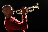 Man Playing Trumpet close-up side view