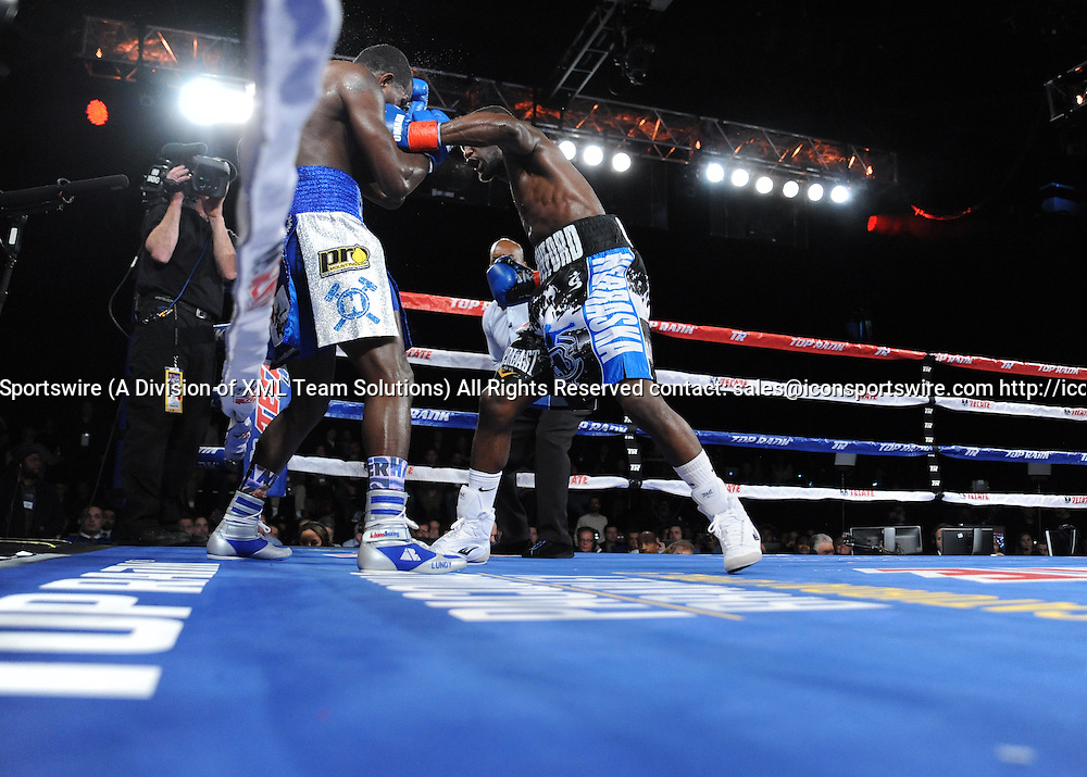 February 27, 2016:  Terrance Crawford pounces on Henry Lundy in the corner as he retains the WBO Lightweight title by TKO of Round 5, while in action against Henry Lundy during a boxing match at the Theater at Madison Square Garden in New York, New York