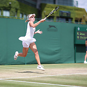 LONDON, ENGLAND - JULY 13:  Katie Swan of Great Britain in action against Whitney Osuigwe of the United States in the Girls' Singles Tournament during the Wimbledon Lawn Tennis Championships at the All England Lawn Tennis and Croquet Club at Wimbledon on July 13, 2017 in London, England. (Photo by Tim Clayton/Corbis via Getty Images)